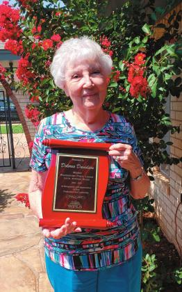 Leanna Cook/WDN Dolores Davidson shows off the plaque commemorating her service with the Weatherford Public Library Local Advisory Board.