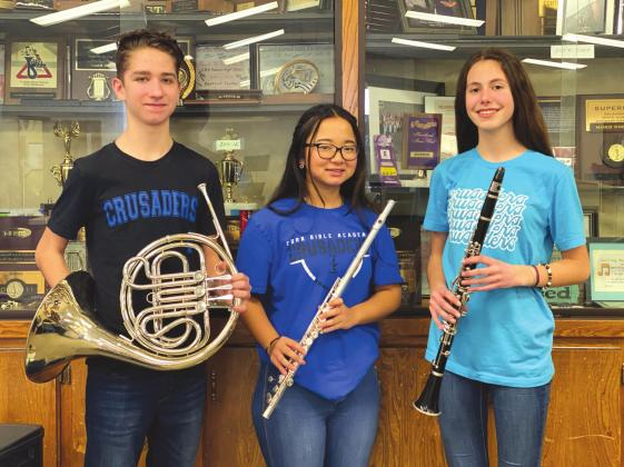 The Crusader Band earned a superior rating as a large ensemble at District Solo and Ensemble Contest and will play again at State Solo and Ensemble Contest in April. Four CBA 8th graders — Braxton Driskill, bassoon, Daniela Massoumi, clarinet, Lachlan Penner, horn, and Annie Schmidt, flute also earned superior ratings on their solos. Junior Reed Skarda, clarinet, earned an excellent rating on his solo. Pictured is Lachlan Penner, left,Annie Schmidt and Daniela Massoumi. Provided