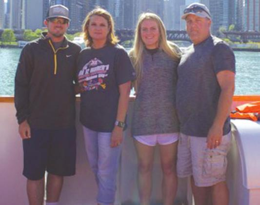 Shelly Pond, second from left, is pictured with her family, children Brooks and Bailee, and husband Doug.Josh Jennings/WDN