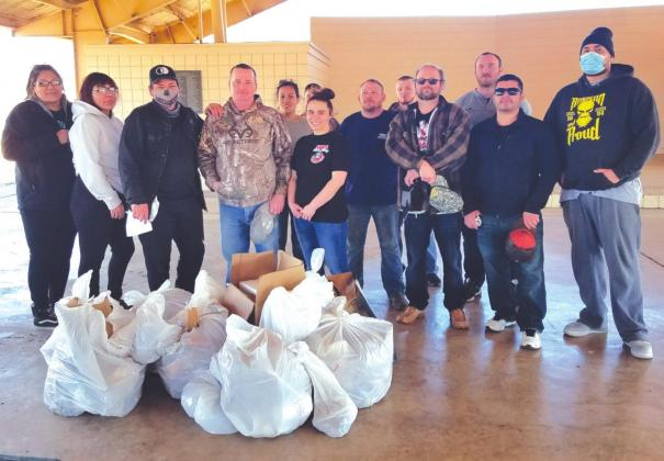 Participants in the Washita-Custer County Treat Court Proram give Lee Park in Cordell a spring cleaning last week. Provided